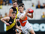 Dylan Shiel of the AFL Giants runs with the ball in their round 18 match against the Tigers July 23, 2017
