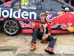 JAMIE WHINCUP driver of the #88 Red Bull Holden Racing Team celebrates after winning the 2017 Supercars Drivers Championship in Newcastle, Australia