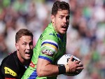 AIDAN SEZER of the Raiders gets away from MATTHEW MOYLAN of the Panthers during the NRL match between the Canberra Raiders and the Penrith Panthers at GIO Stadium in Canberra, Australia.