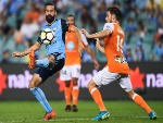 ALEX BROSQUE of Sydney and Jack Hingert of Brisbane contest the ball during the A-League match between Sydney FC and the Brisbane Roar at Allianz Stadium in Sydney, Australia.