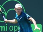 ALEX DE MINAUR of Australia plays a shot against Yoshihito Nishioka of Japan during Miami Open at the Crandon Park Tennis Center in Key Biscayne, Florida.