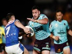 ALEX GLENN of the Broncos makes a run at Shaun Johnson of the Warriors during the NRL match between the New Zealand Warriors and the Brisbane Broncos at Mt Smart Stadium in Auckland, New Zealand.