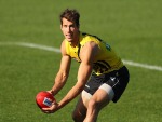 ALEX RANCE of the Tigers runs with the ball during a Richmond Tigers AFL training session at ME Bank Centre in Melbourne, Australia.