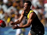ALEX RANCE of the Tigers handpasses the ball during the 2018 AFL match between the Richmond Tigers and the Fremantle Dockers at the MCG in Melbourne, Australia.