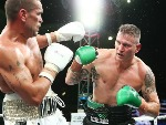 Australian boxers ANTHONY MUNDINE and DANNY GREEN fight during their cruiserweight bout at Adelaide Oval in Adelaide, Australia.