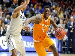 ARMANI MOORE of the Tennessee Volunteers dribbles the ball during the win over the Vanderbilt Commodores during the SEC Basketball Tournament at Bridgestone Arena in Nashville, Tennessee