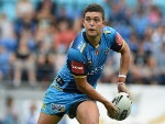 ASHLEY TAYLOR of the Titans looks to pass the ball during the NRL match between the Gold Coast Titans and the Melbourne Storm in Gold Coast, Australia.