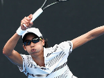 ASTRA SHARMA plays a forehand during the Australian Open Play-off at Melbourne Park in Melbourne, Australia.