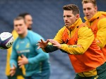 BERNARD FOLEY of Australia passes the ball during the Australia Captain's Run at Murrayfield Stadium in Edinburgh, Scotland.