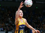 CAITLIN BASSETT of the Lightning gathers the ball during the Super Netball match between the Magpies and the Lightning at Margaret Court Arena in Melbourne, Australia.