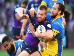 CAMERON MUNSTER of the Storm is tackled during the NRL Qualifying Final match between the Melbourne Storm and the Parramatta Eels at AAMI Park in Melbourne, Australia.