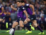 CAMERON SMITH of the Storm kicks during the 2017 NRL Grand Final match between the Melbourne Storm and the North Queensland Cowboys at ANZ Stadium in Sydney, Australia.