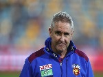 Lions coach CHRIS FAGAN looks on during the AFL match between the Brisbane Lions and the Geelong Cats at The Gabba in Brisbane, Australia.