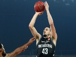 CHRIS GOULDING of Melbourne United (R) shoots during the NBL Grand Final series between Melbourne United and the Adelaide 36ers at Hisense Arena in Melbourne, Australia.