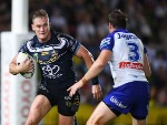 COEN HESS of the Cowboys looks to get past Josh Morris of the Bulldogs during the NRL match between the North Queensland Cowboys and the Canterbury Bulldogs at 1300SMILES Stadium in Townsville, Australia.