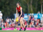DAISY PEARCE of the Demons runs with the ball during the AFLW match between the Melbourne Demons and the Greater Western Sydney Giants at Casey Fields in Melbourne, Australia.