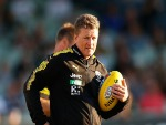 DAMIEN HARDWICK, coach of the Tigers looks on during the AFL JLT Community Series match between the Richmond Tigers and the North Melbourne Kangaroos at Ikon Park in Melbourne, Australia.