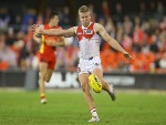 DAN HANNEBERY of the Swans kicks during the AFL match between the Gold Coast Suns and the Sydney Swans at Metricon Stadium in Gold Coast, Australia.