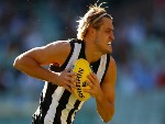 DARCY MOORE of the Magpies runs with the ball during the AFL match between the Collingwood Magpies and the Greater Western Sydney Giants at MCG in Melbourne, Australia.