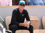 DARREN CAHILL, coach of Simona Halep of Romania watches her face Angelique Kerber of Germany in the ladies singles quarter finals match during the 2018 French Open at Roland Garros in Paris, France.