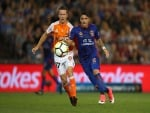 DIMITRI PETRATOS of the Jets and Matthew McKay of the Roar to contest the ball during the A-League match between the Newcastle Jets and the Brisbane Roar at McDonald Jones Stadium in Newcastle, Australia.