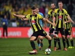 DYLAN FOX of the Phoenix passes the ball during between the Wellington Phoenix and Melbourne City FC in Auckland, New Zealand.
