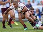 DYLAN WALKER of Manly is tackled during the NRL match between the Parramatta Eels and the Manly Sea Eagles at ANZ Stadium in Sydney, Australia.