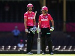 ELLYSE PERRY and ALYSSA HEALY of the Sixers talk between overs during the Women's Big Bash League match between the Sydney Sixers and the Brisbane Heat at SCG in Sydney, Australia.