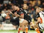 ISSAC LUKE of the Warriors passes the ball out during the NRL match between the New Zealand Warriors and the Wests Tigers at Mt Smart Stadium in Auckland, New Zealand.