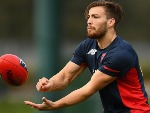 JACK VINEY of the Demons handballs during a Melbourne Demons AFL training session at Gosch's Paddock in Melbourne, Australia.