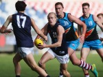 JAIDYN STEPHENSON of Vic Metro runs with the ball during the AFL Championships match between Vic Metro and the Allies at Simonds Stadium in Geelong, Australia.