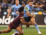 JAMES TEDESCO of the Blues is tackled by Felipe Kaufusi of the Maroons during the State Of Origin series between the Queensland Maroons and the New South Wales Blues at the MCG in Melbourne, Australia.