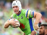 JARROD CROKER of the Raiders is tackled during the NRL match between the Canberra Raiders and the New Zealand Warriors at GIO Stadium in Canberra, Australia.