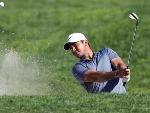 JASON DAY of Australia plays a shot from a bunker on the ninth hole during the final round of the Farmers Insurance Open at Torrey Pines South in San Diego, California.