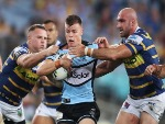 JAYDEN BRAILEY of the Sharks is tackled during the NRL match between the Parramatta Eels and the Cronulla Sharks at ANZ Stadium in Sydney, Australia.