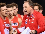 Swans head coach JOHN LONGMIRE talks to his players during the AFL match between the Essendon Bombers and the Sydney Swans at ES in Melbourne, Australia.