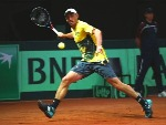 JOHN MILLMAN of Australia in action against David Goffin of Belgium during the Davis Cup World Group semi final match at Palais 12 in Brussels, Belgium.