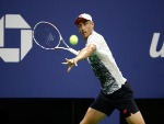 JOHN MILLMAN of Australia returns the ball during his men's singles quarter-final match against Novak Djokovic of Serbia of the US Open at the USTA Billie Jean King National Tennis Center in New York City.