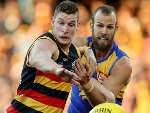 JOSH JENKINS of the Crows is tackled by Will Schofield of the Eagles during the AFL match between the Adelaide Crows and the West Coast Eagles at the Adelaide Oval in Adelaide, Australia.