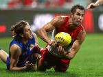 JOSH KENNEDY of the Swans gets a handball away despite pressure from Marcus Bontempelli of the Bulldogs during the AFL match between the Sydney Swans and the Western Bulldogs at SCG in Sydney, Australia.