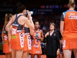 JULIE FITZGERALD talks to her players during a time out during the Super Netball match between the Giants and the Lightning at Qudos Bank Arena in Sydney, Australia.