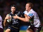 KALYN PONGA of the Cowboys is tackled by Jake Trbojevic of the Sea Eagles during the NRL match between the North Queensland Cowboys and the Manly Sea Eagles at 1300SMILES Stadium in Townsville, Australia.