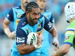 KONRAD HURRELL of the Titans runs the ball during the NRL match between the Gold Coast Titans and the Canberra Raiders at Cbus Super Stadium in Gold Coast, Australia.
