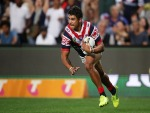LATRELL MITCHELL of the Roosters scores a try during the NRL Preliminary Final match between the Sydney Roosters and the North Queensland Cowboys at Allianz Stadium in Sydney, Australia.