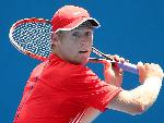 LUKE SAVILLE of Australia plays a backhand in his match against Amir Weintraub of Israel Australian Open Qualifying in Melbourne, Australia.