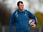 MICHAEL CHEIKA, Head Coach of Australia looks on during a training session at the Lensbury Hotel in London, England.