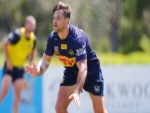 MITCH REIN passes the ball during a Gold Coast Titans NRL training session at Parkwood in Gold Coast, Australia.