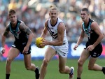 NAT FYFE of the Dockers is chased by Hamish Hartlett and Darcy Byrne-Jones of the Power during the 2018 AFL match between the Port Adelaide Power and the Fremantle Dockers at Adelaide Oval in Adelaide, Australia.