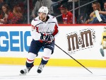 NATHAN WALKER #79 of the Washington Capitals skates against the New Jersey Devils during a preseason game at the Prudential Center in Newark, New Jersey.