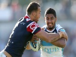 NENE MACDONALD of the Titans is tackled by Blake Ferguson of the Roosters during the NRL match between the Sydney Roosters and the Gold Coast Titans at Central Coast Stadium in Gosford, Australia.
